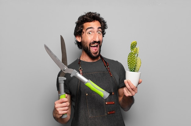 若いひげを生やした男の庭師の概念