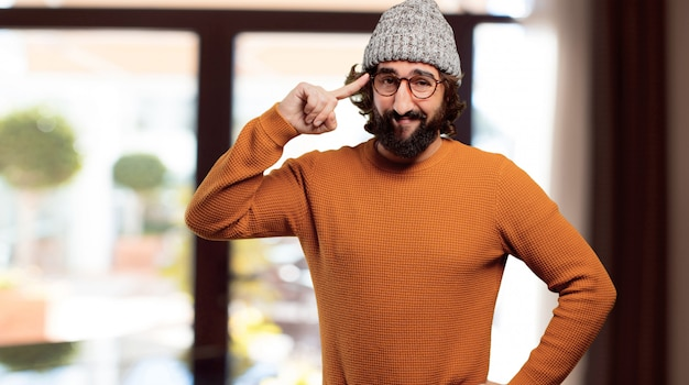 Young bearded man having an idea