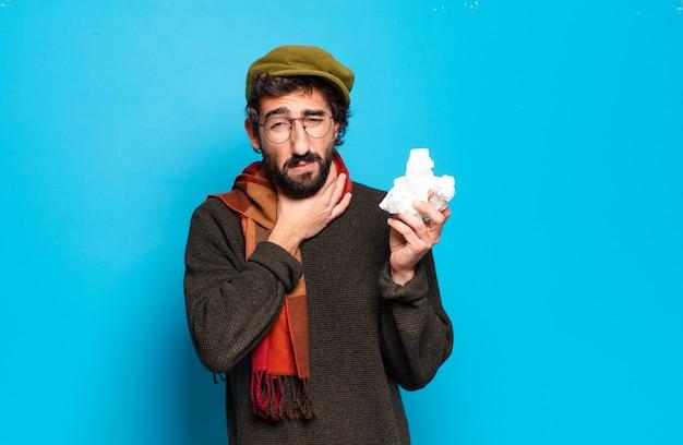若いひげを生やした男の病気の概念。風邪やインフルエンザの痛み