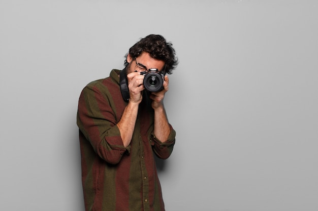 Young bearded man photographer concept