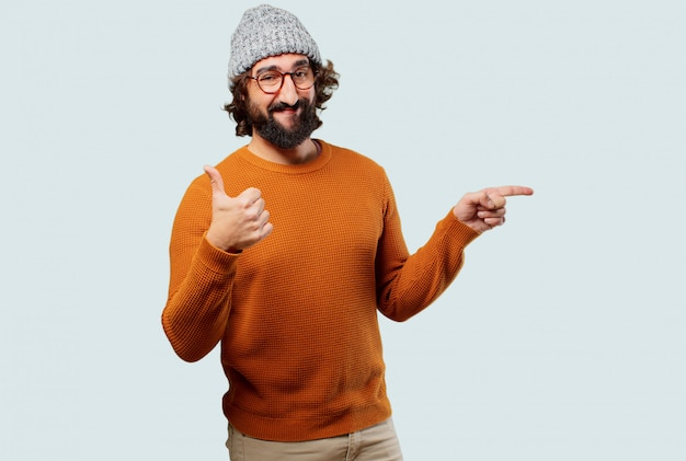 Young bearded man pointing