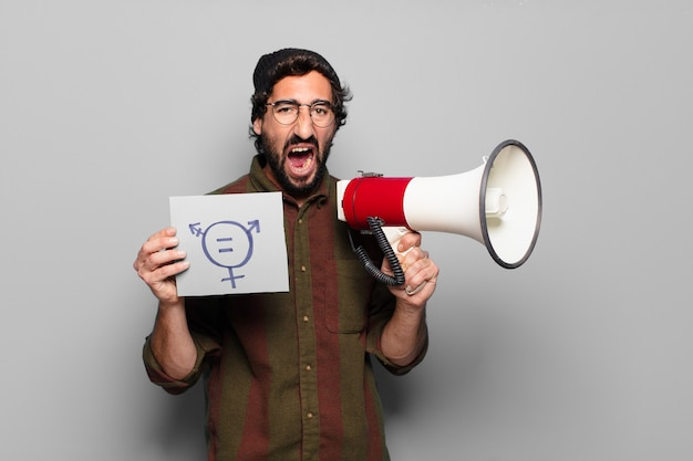 Young bearded man protesting with a megaphone