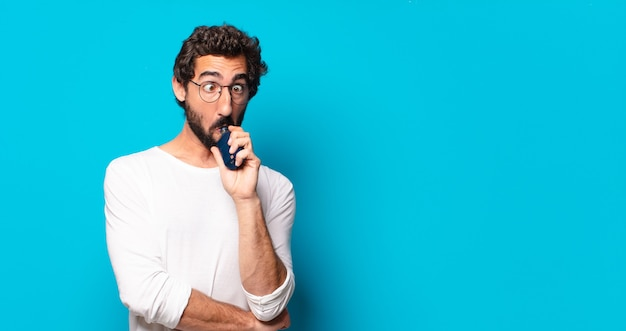 Young bearded man smoking with a vaper