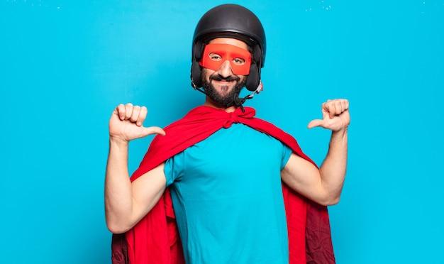Young bearded man in superhero costume