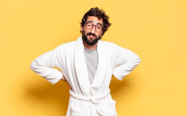 Young bearded man wearing bathrobe
