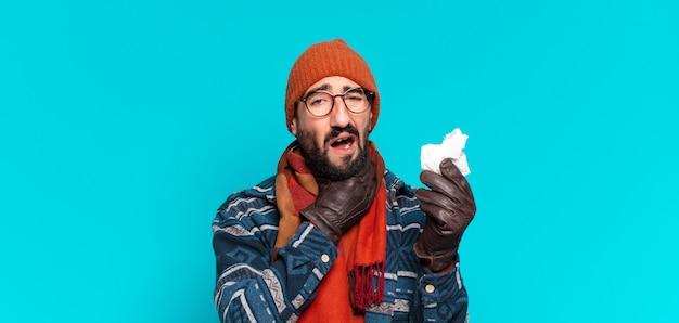 겨울 옷을 입고 젊은 수염된 남자