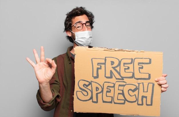 医療マスクと言論の自由の概念を持つ若いひげを生やした男