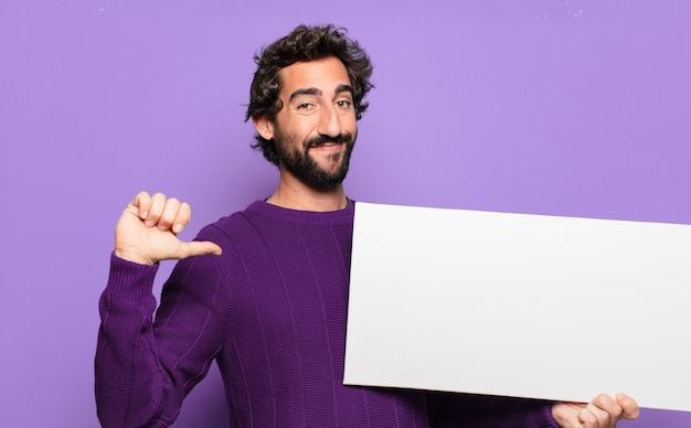 Young bearded man with a blank banner