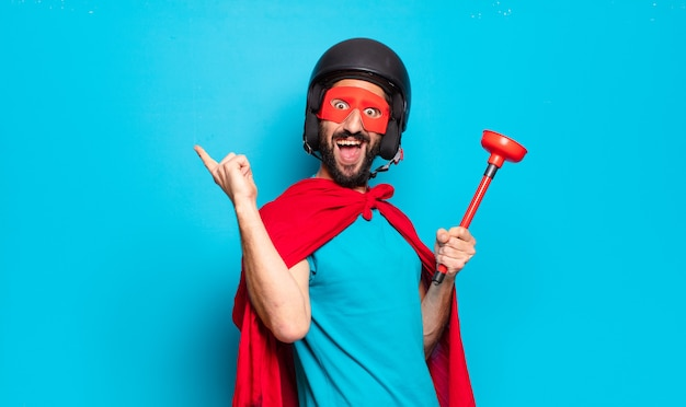 Young bearded man with cape and mask