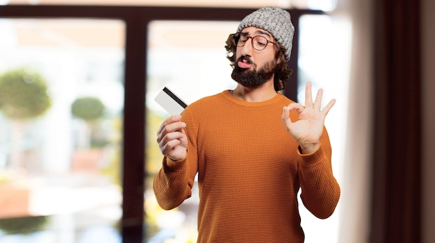 Young bearded man with credit card