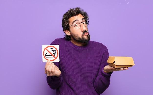 금지 된 음식 보드와 수염 된 젊은이