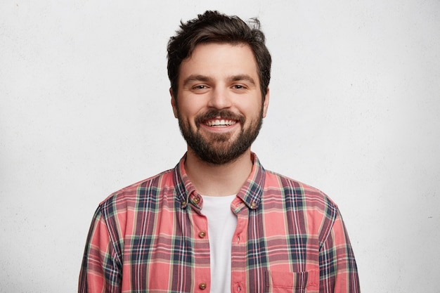 Young bearded man with striped shirt