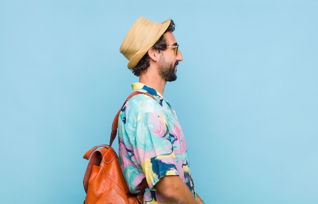 Young bearded tourist man in shirt isolated