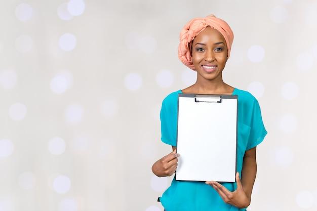 Young beautiful african american woman showing clipboard