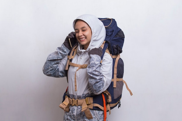 Young beautiful asian hiker woman using mobile phone isolated on white background