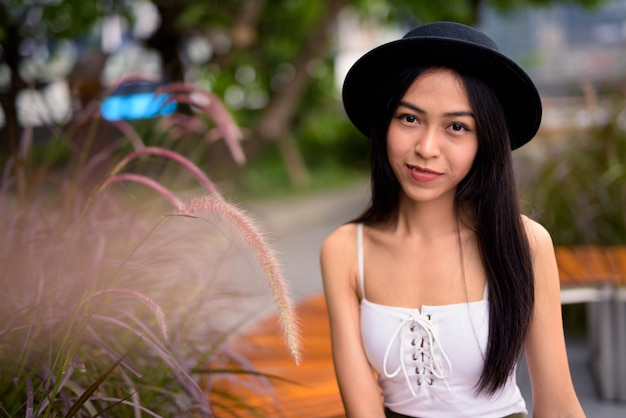 Young beautiful asian tourist woman at the rooftop garden