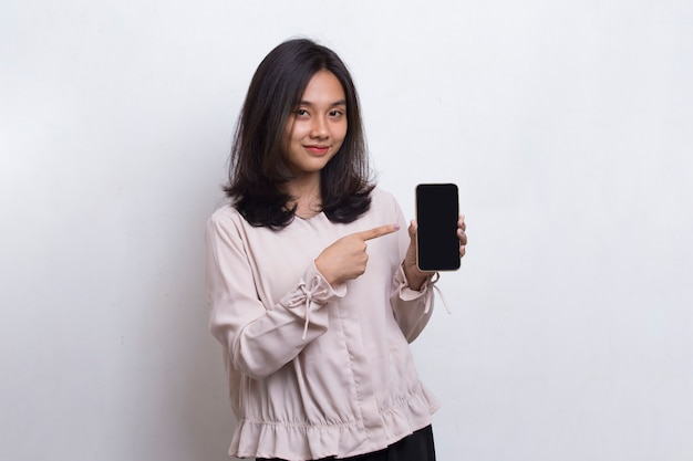 Young beautiful asian woman demonstrating mobile cell phone isolated on white background
