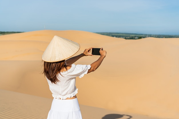 Young beautiful asian woman enjoy the moment in desert.