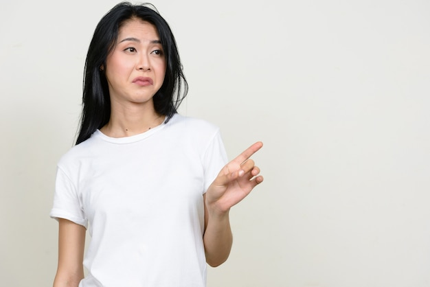Young beautiful asian woman isolated