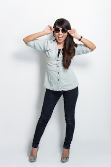 Young beautiful asian woman with sunglasses, posing