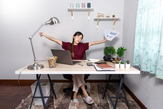 Young beautiful asian woman working at home