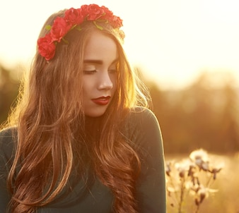 Young, beautiful, attractive model woman posing on sunset background.