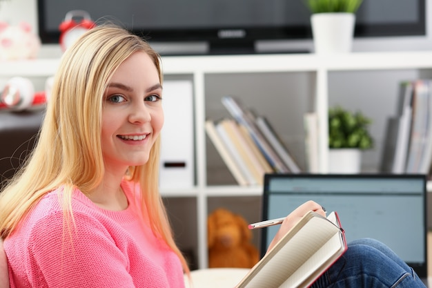 Young beautiful blond woman working at home