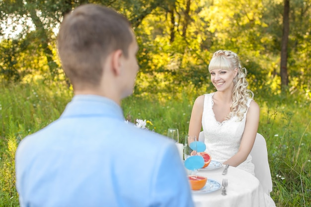 Young beautiful bride on the nature in summer