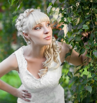 The young beautiful bride on the nature