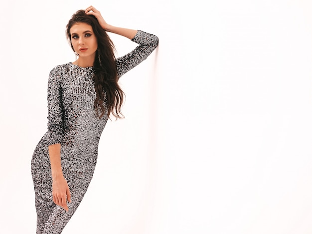 Young beautiful brunette girl in nice trendy summer shiny dress