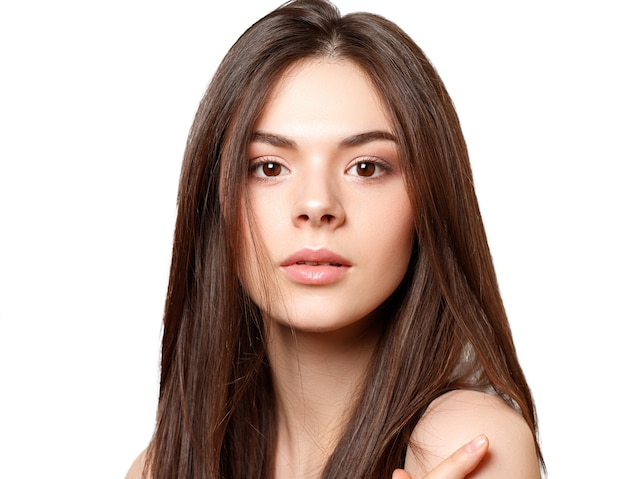 Young beautiful brunette with straight long flowing hair isolated on white background