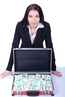 Young beautiful business woman presenting a lot of money.