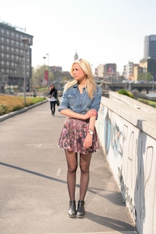 Young beautiful caucasian blonde girl in the city