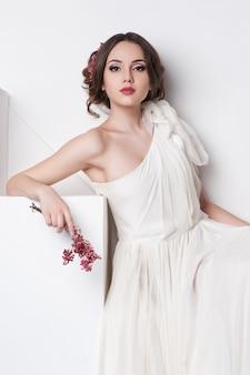 Young beautiful caucasian woman in gorgeous dress