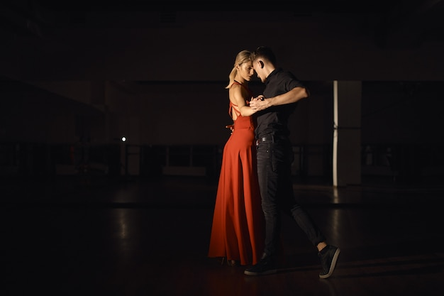 Young beautiful couple dancing with passion