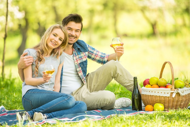 Young beautiful couple dressed casual having picnic.