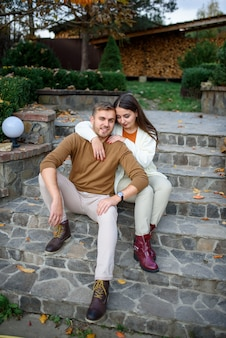 Young beautiful couple is sitting on the steps.
