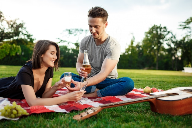 Young beautiful couple resting at park
