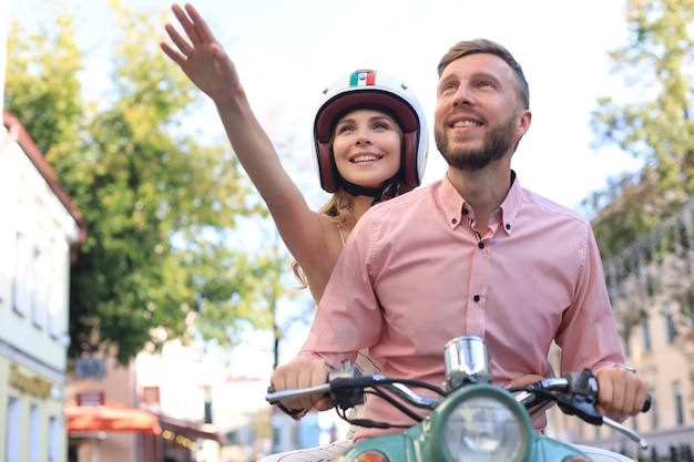 Young beautiful couple riding on motorbike. adventure and vacations concept.
