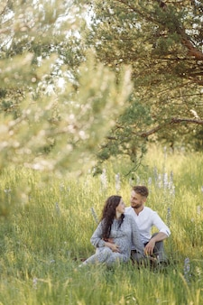 Young beautiful couple spend time in the garden