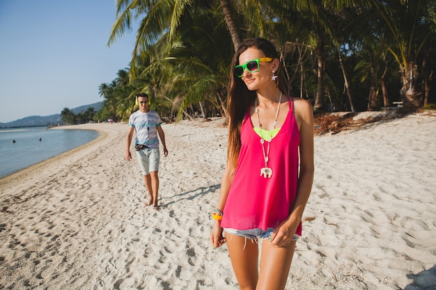 Young beautiful couple walking on tropical beach, thailand, holiday roomance, hipster outfit, casual style, honey moon, vacation, summertime, sunny, romantic mood