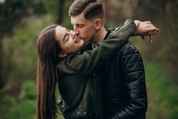 Young beautiful couple in the woods together