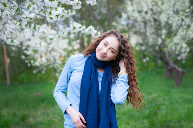 Young beautiful fashionable woman in park