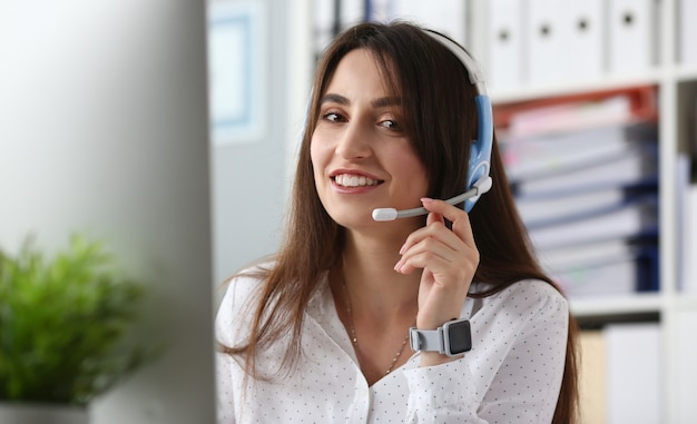 Young beautiful female employee of the call center