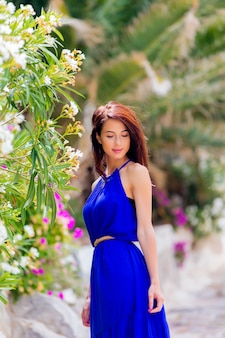 Young beautiful girl in blue dress on vacation