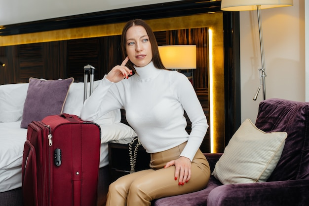 A young beautiful girl checked into her room in a luxury hotel. tourism and recreation.