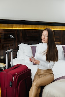 A young beautiful girl checked into her room in a luxury hotel