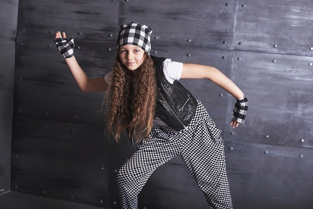 Young beautiful girl dancing in a trendy clothes