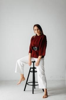 Young beautiful girl in studio, fashion portrait