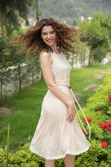 Young beautiful girl in a summer dress
